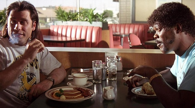 "In this undated handout image courtesy Miramax and provided by the Library of Congress , Vincent, played by John Travolta, left, dismisses Jules', played by Samuel L. Jackson, plan to ""walk the earth,"" in a scene from the 1994 Quentin Tarrantino film, ""Pulp Fiction."" The library is inducting 25 films, including ""Pulp Fiction,"" into the National Film Registry to be preserved for their cultural, historical or cinematic significance. (AP Photo/Library of Congress, Courtesy of Miramax)"